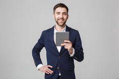 Business Concept - Portrait Handsome Business man playing digital tablet with smiling confident face. White Background. Copy Space.  stock photos