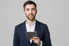Business Concept - Portrait Handsome Business man playing digital tablet with smiling confident face. White Background. Copy Space.  stock photo