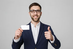 Business Concept - Portrait Handsome Business man showing name card with smiling confident face and thump up. White Background.Cop Stock Image