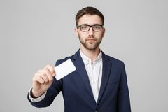 Business Concept - Portrait Handsome Business man showing name card with smiling confident face. White Background.Copy. Space Royalty Free Stock Photography