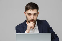 Business Concept - Portrait handsome stressful business man in suit shock looking at work in laptop. White Background. Royalty Free Stock Images
