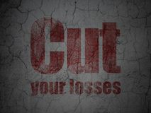 Business concept: Cut Your losses on grunge wall background. Business concept: Red Cut Your losses on grunge textured concrete wall background royalty free stock photo