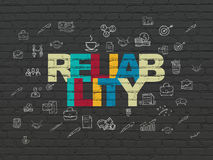 Business concept: Reliability on wall background. Business concept: Painted multicolor text Reliability on Black Brick wall background with  Hand Drawn Business Stock Image