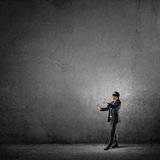 Business concept of risk with businessman wearing blindfold in empty concrete room Stock Photo