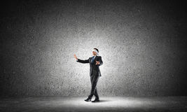 Business concept of risk with businessman wearing blindfold in empty concrete room Royalty Free Stock Photography