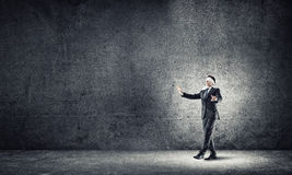 Business concept of risk with businessman wearing blindfold in empty concrete room Royalty Free Stock Photo