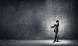 Business concept of risk with businessman wearing blindfold in empty concrete room Stock Photos