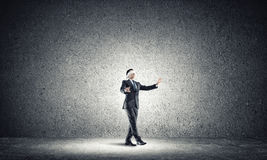 Business concept of risk with businessman wearing blindfold in empty concrete room Stock Photography