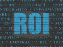 Business concept: ROI on wall background. Business concept: Painted blue text ROI on Black Brick wall background with  Tag Cloud Royalty Free Stock Photo