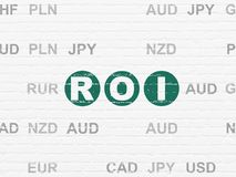 Business concept: ROI on wall background. Business concept: Painted green text ROI on White Brick wall background with Currency Royalty Free Stock Photography