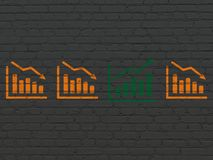 Business concept: growth graph icon on wall background. Business concept: row of Painted orange decline graph icons around green growth graph icon on Black Brick Royalty Free Stock Photos