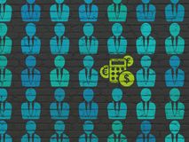 Business concept: calculator icon on wall background. Business concept: rows of Painted blue business man icons around green calculator icon on Black Brick wall Royalty Free Stock Photography
