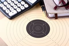 Setting goals, target, calculator, notebook, glasses Stock Photos