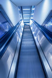 Business Concept shot motion blur of escalator leading up in modern building. perfect background for business related projects Royalty Free Stock Photography