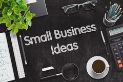Small Business Ideas on Black Chalkboard. 3D Rendering. Business Concept - Small Business Ideas Handwritten on Black Chalkboard. Top View Composition with stock images