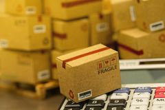 Business concept: Small cardboard boxes and calculator. Concept. Of Increasing product rates the expansion of export business to plan marketing or finance go royalty free stock image