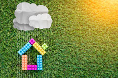 Business concept. small house and raining on grass Royalty Free Stock Photos