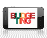 Business concept: Smartphone with Budgeting on  display. Business concept: Smartphone with Painted multicolor text Budgeting on display, 3D rendering Stock Photos