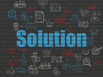 Business concept: Solution on wall background Royalty Free Stock Photo