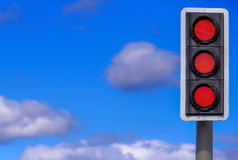 Business Concept: Stop and Think!. British traffic lights with the red light illuminated on all three lights Stock Image