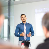 Business concept and strategy presentation on corporate meeting. Businessman making a presentation at office. Business executive delivering a presentation to Stock Photos