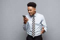 Business Concept - Stressful african american businessman shouting and screaming on mobile phone. Business Concept - Stressful african american businessman Stock Photos