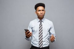 Business Concept - Stressful african american businessman shouting and screaming on mobile phone. Business Concept - Stressful african american businessman Stock Photography