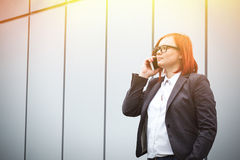 Business concept of success and telephone conversations. Serious Royalty Free Stock Photos