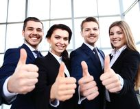 Business concept - successful young business people. Showing thumbs up Royalty Free Stock Photo