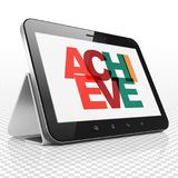 Business concept: Tablet Computer with Achieve on  display. Business concept: Tablet Computer with Painted multicolor text Achieve on display, 3D rendering Royalty Free Stock Photo