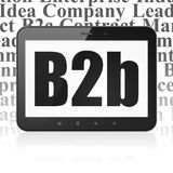 Business concept: Tablet Computer with B2b on display. Business concept: Tablet Computer with  black text B2b on display,  Tag Cloud background, 3D rendering Stock Photo