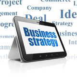 Business concept: Tablet Computer with Business Strategy on display. Business concept: Tablet Computer with  blue text Business Strategy on display,  Tag Cloud Royalty Free Stock Images