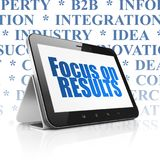 Business concept: Tablet Computer with Focus on RESULTS on display Royalty Free Stock Photo