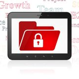 Business concept: Tablet Computer with Folder With Lock on display. Business concept: Tablet Computer with  red Folder With Lock icon on display,  Tag Cloud Stock Image
