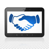 Business concept: Tablet Computer with Handshake on display. Business concept: Tablet Computer with blue Handshake icon on display, Tag Cloud background, 3D royalty free illustration