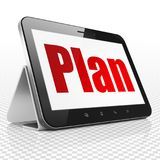 Business concept: Tablet Computer with Plan on display. Business concept: Tablet Computer with red text Plan on display, 3D rendering Royalty Free Stock Photo
