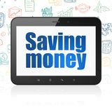 Business concept: Tablet Computer with Saving Money on display Royalty Free Stock Photography