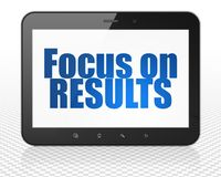 Business concept: Tablet Pc Computer with Focus on RESULTS on display. Business concept: Tablet Pc Computer with blue text Focus on RESULTS on display, 3D Royalty Free Stock Images