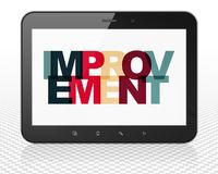Business concept: Tablet Pc Computer with Improvement on  display. Business concept: Tablet Pc Computer with Painted multicolor text Improvement on display, 3D Royalty Free Stock Photo