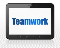 Business concept: Tablet Pc Computer with Teamwork on display. Business concept: Tablet Pc Computer with blue text Teamwork on display, 3D rendering Royalty Free Stock Photo