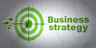 Business concept: target and Business Strategy on wall background. Success business concept: arrows hitting the center of target, Green Business Strategy on wall Stock Images