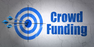 Business concept: target and Crowd Funding on wall. Success business concept: arrows hitting the center of target, Blue Crowd Funding on wall background, 3d Royalty Free Stock Photo