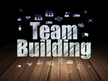 Business concept: Team Building in grunge dark room Royalty Free Stock Image