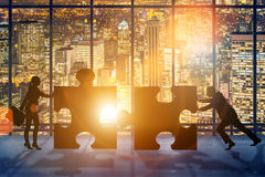 The business concept of teamwork with jigsaw puzzle Stock Photography