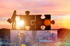 The business concept of teamwork with jigsaw puzzle Stock Photo