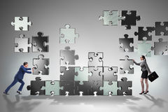The business concept of teamwork with puzzle pieces Royalty Free Stock Photography