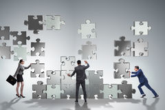 The business concept of teamwork with puzzle pieces Stock Photo