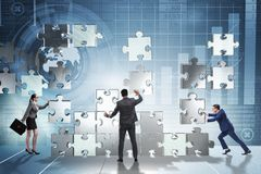 The business concept of teamwork with puzzle pieces Stock Photos