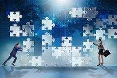 The business concept of teamwork with puzzle pieces Royalty Free Stock Images