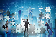 The business concept of teamwork with puzzle pieces. Business concept of teamwork with puzzle pieces stock photo